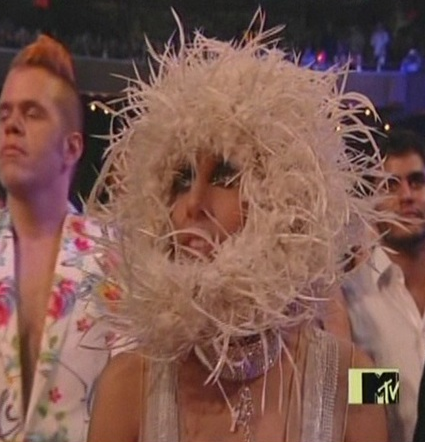 Lady Gaga does her best barn owl impersonation.